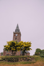 rural brick church with steeple on a hill in Scotland