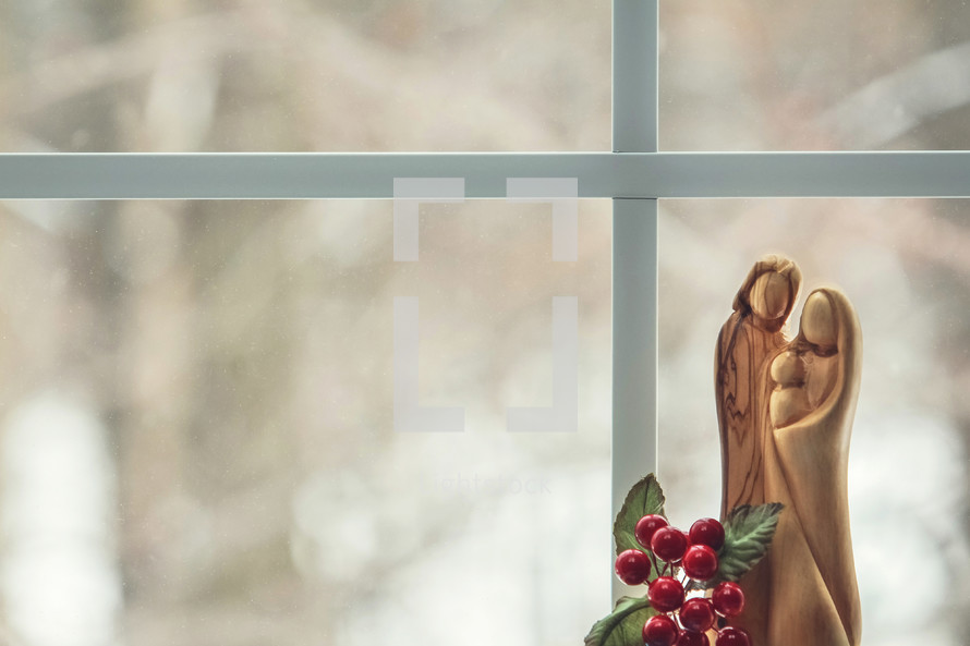 wooden nativity figurines in a window