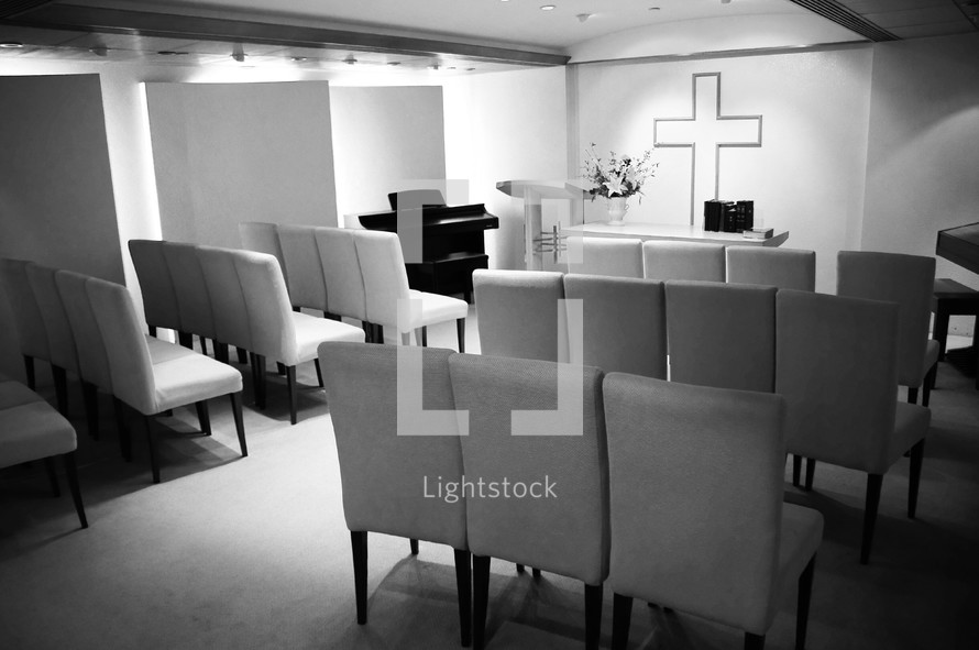 Empty chairs in a small chapel
