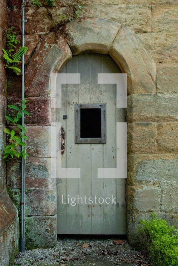 door in an arched doorway