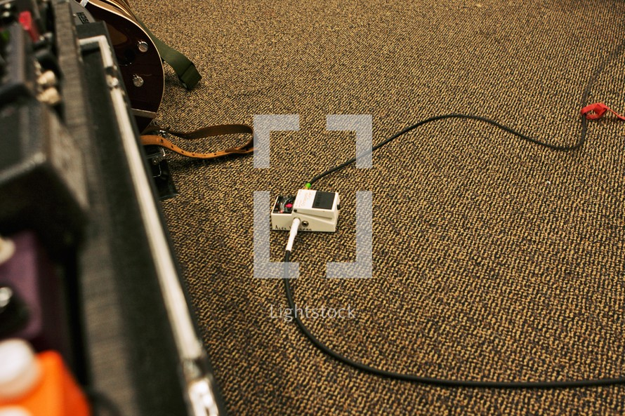 carpet floor with band equipment, cord