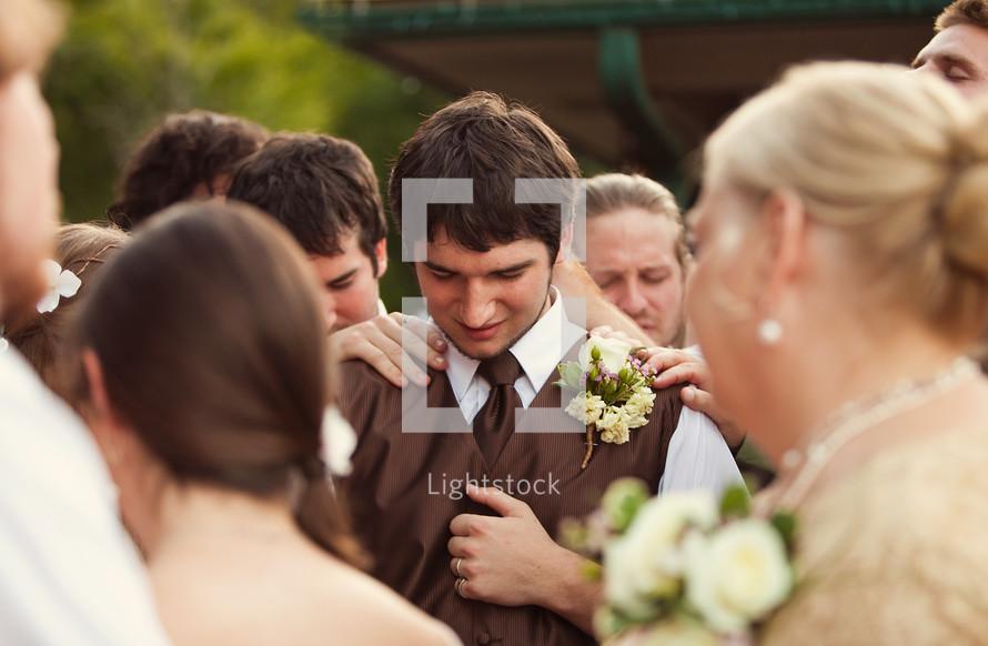 group prayer at a wedding
