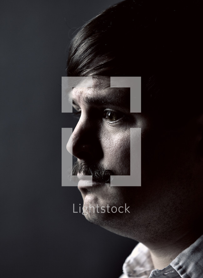 profile of a man with a mustache
