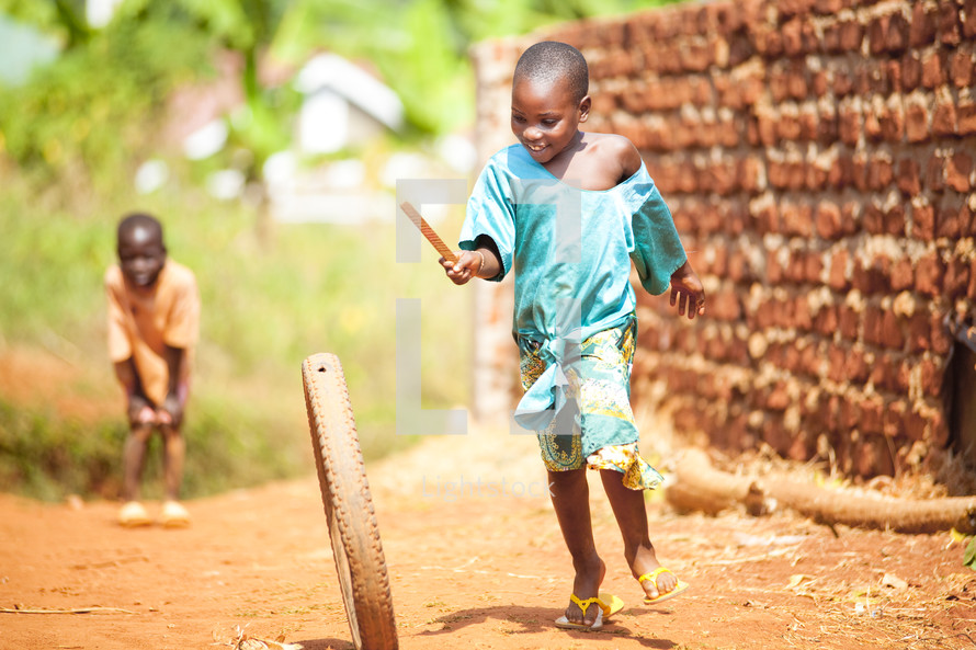 African children playing with bike wheel