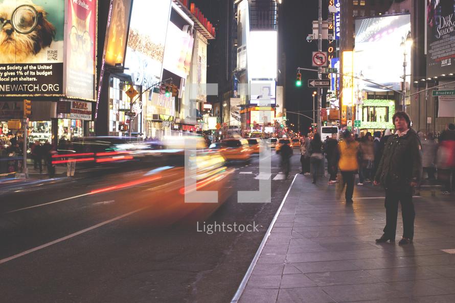 city lights on the sidewalk at night