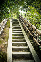 Steps with railings going up a hill.