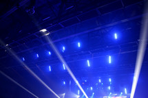 spotlights shining above an audience