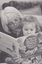 Grandma reading to her granddaughter