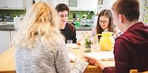 teens in a prayer circle at a Bible study