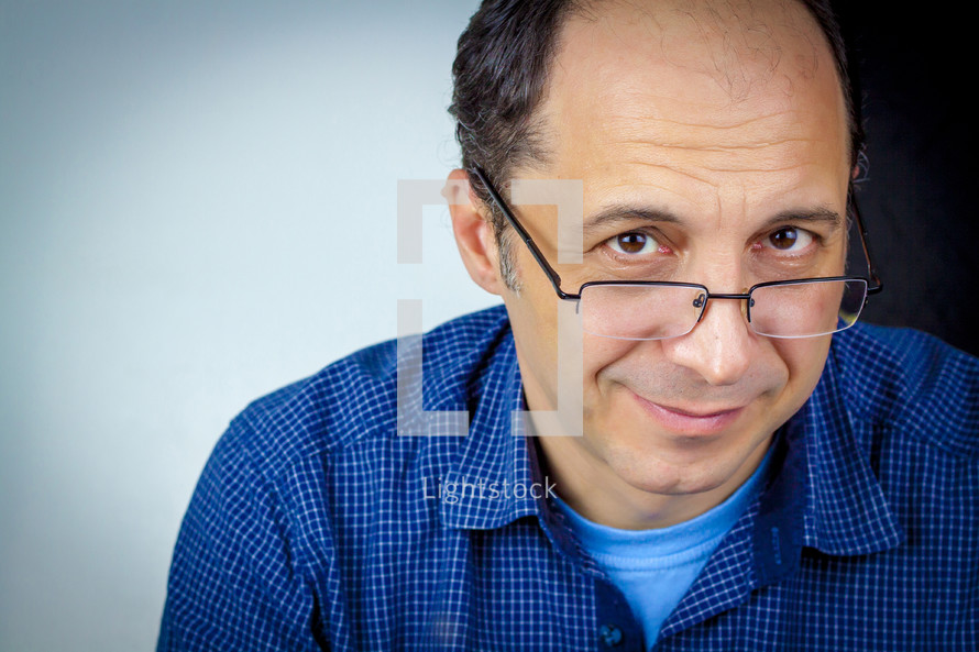 head shot of a man in glasses