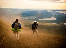 men hiking down hill in Japan