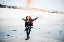 woman outdoors with orange smoke