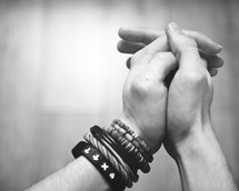 praying hands and bracelets