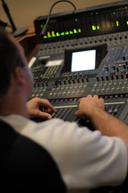 Man operating a production board.