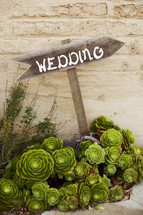 wedding sign pointing the way