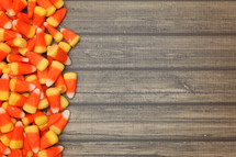 candy corn on a wood background