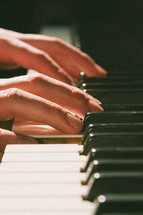 hands on a piano