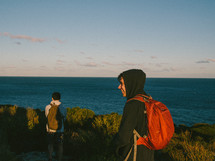 teen boys hiking along a coastline