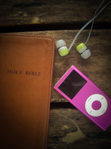 A Holy Bible, iPod, and earbuds