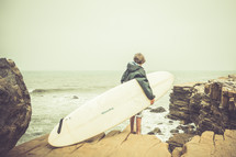teen boy and a surf board