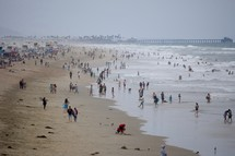 crowded beach on an overcast day