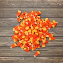 candy corn on wood background