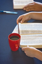 A Table Set for a Bible Study as People Search the Scriptures