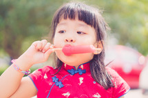 girl eating a popsicle