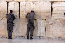 Israeli Jewish soldiers worshiping at the Western Wall in Jerusalem.