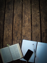 open Bible, Bible, pages, pen, earbuds, iPhone, cellphone, notebook