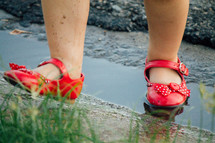 red shoes in a puddle