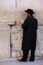 Orthodox Jew worshiping at the Western Wall in Jerusalem.