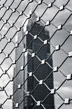 skyscraper behind a gate