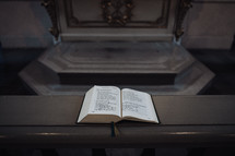 open Bible on a railing