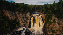 muddy waterfall in a river