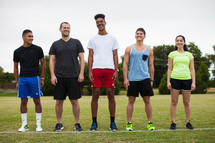 athletes standing on a sports field