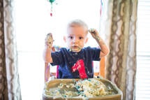 a cake smash for a toddlers first birthday