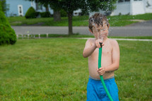 a child holding a hose