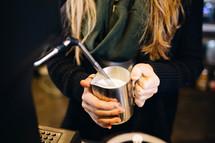 barista frothing milk