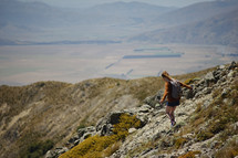 a woman hiking on a mountain landscape