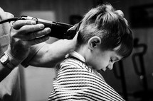 a boy child at the barber shop