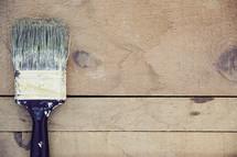 paint brush on a wood floor