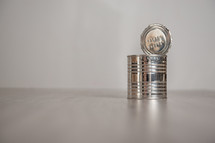 open tin can on a light background