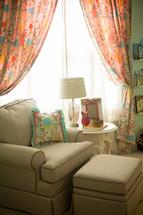 armchair and ottoman near a window