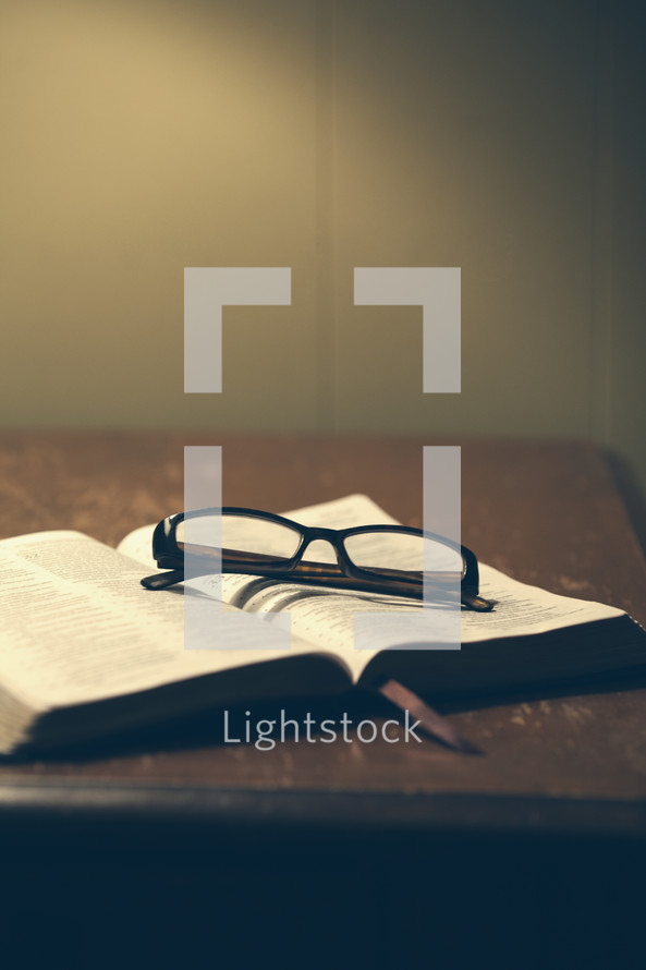 reading glasses on a Bible