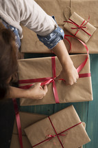 a woman wrapping Christmas gifts