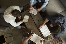 high point of view men in discussion at a Bible study.