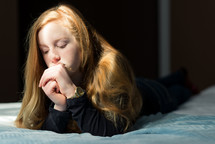 teen girl with praying hands