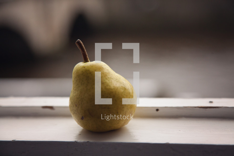 pear in a window sill