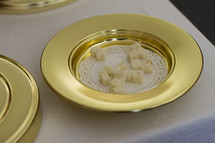 bread cubes in a communion tray